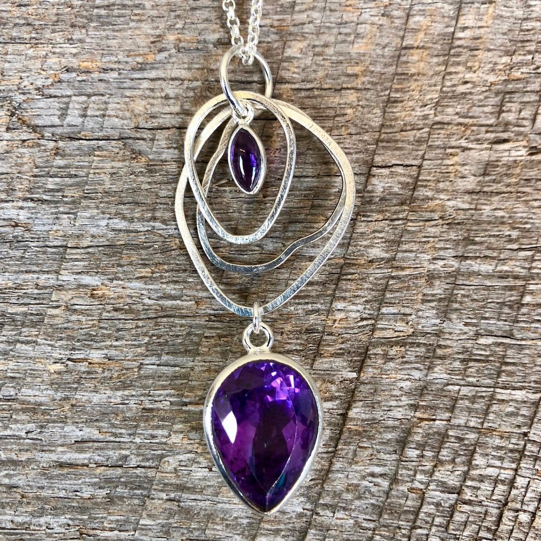 Amethyst with silver circles